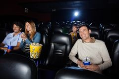 Happy People Watching Film Royalty Free Stock Image