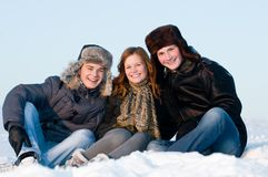Happy people in winter Stock Images