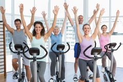 Happy people working out at spinning class Royalty Free Stock Image