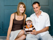 Happy perfect young family Stock Photos