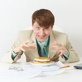 Happy person is going to eat on workplace Stock Photography