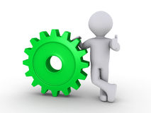 Happy person holding cogwheel. 3d person holding a green cogwheel Stock Images