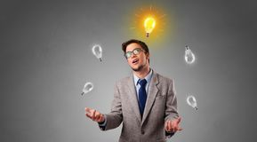 Happy person juggle with bulbs. Young business person juggle with new idea conceptn royalty free stock images