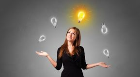 Happy person juggle with bulbs. Young business person juggle with new idea concept stock images