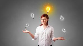 Happy person juggle with bulbs. Young business person juggle with new idea conceptn royalty free stock photography