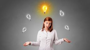 Happy person juggle with bulbs. Young business person juggle with new idea conceptn stock photography