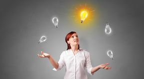 Happy person juggle with bulbs. Young business person juggle with new idea concept royalty free stock photo