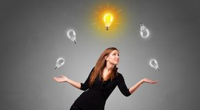 Happy person juggle with bulbs. Young business person juggle with new idea concept royalty free stock photos