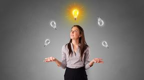 Happy person juggle with bulbs. Young business person juggle with new idea concept stock photo
