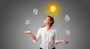 Happy person juggle with bulbs. Young business person juggle with new idea concept stock image