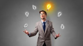 Happy person juggle with bulbs. Young business person juggle with new idea conceptn royalty free stock photo