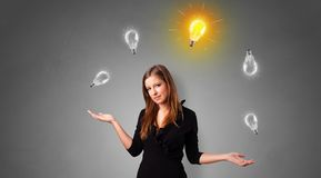 Happy person juggle with bulbs. Young business person juggle with new idea conceptn stock photos