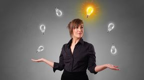 Happy person juggle with bulbs. Young business person juggle with new idea concept royalty free stock image