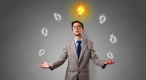 Happy person juggle with bulbs. Young business person juggle with new idea concept stock photography