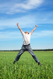 Happy person jumping royalty free stock photography