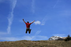 Happy person is jumping up Stock Images