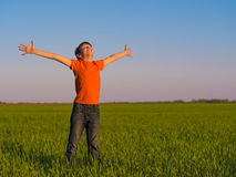 Happy person in the nature with raised arms Stock Images