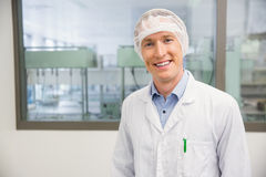 Happy pharmacist in a hairnet Royalty Free Stock Photos
