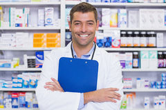 Happy pharmacist holding clipboard stock photography