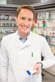 Happy pharmacist holding medicine boxes Stock Image