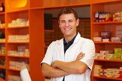 Happy pharmacist in pharmacy Stock Photos
