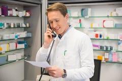 Happy pharmacist on the phone Stock Photos