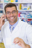 Happy pharmacist on the phone Royalty Free Stock Photo