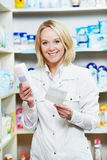 Happy Pharmacy chemist woman in drugstore Stock Photography