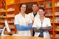 Happy pharmacy team royalty free stock photos