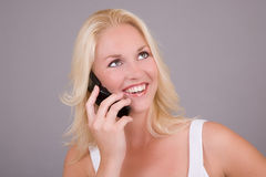 Happy on the phone Stock Images