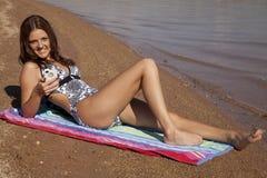 Happy phone beach Royalty Free Stock Photography
