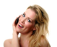 Happy phone call. Smiling blonde talking happily on the phone Stock Images