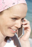 Happy phone call. Woman at the beach having happy conversation royalty free stock images
