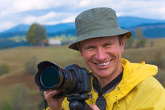 Happy photographer on autumn mountain background Royalty Free Stock Photos