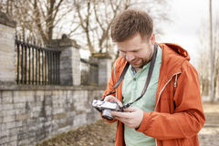 Happy photographer looks at the resulting photos royalty free stock images