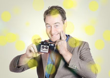 Happy photographer man holding camera with smile Stock Photo