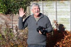 Happy photographer waving. Royalty Free Stock Photos