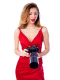Happy photographer woman holding camera, isolated on white backg Stock Images