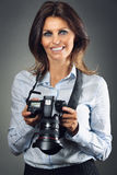 Happy photographer woman smiling Stock Images