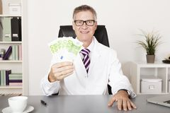 Happy Physician Holding Cash Stock Photos