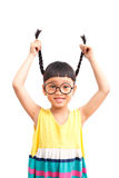 Happy pigtail. Asian little girl with raise her pigtail Stock Photos