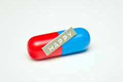 Happy pill for depression or anxiety. A capsule with the word HAPPY on it which could be prescribed by a psychiatrist or psychologist for depression or anxiety stock images