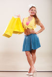 Happy pin up girl woman with bags shopping. Royalty Free Stock Photo