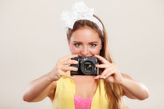 Happy pin up girl woman filming with camcorder. Stock Image
