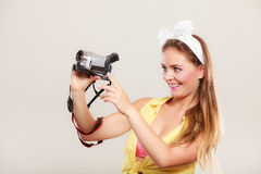 Happy pin up girl woman filming with camcorder. Royalty Free Stock Photography