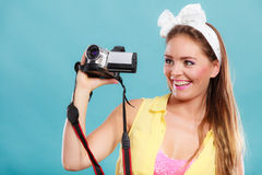Happy pin up girl woman filming with camcorder. Stock Images