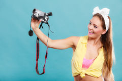 Happy pin up girl woman filming with camcorder. Stock Photos