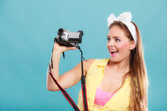 Happy pin up girl woman filming with camcorder. Stock Photography