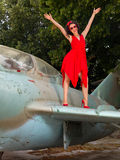 Happy pin-up model on vintage airplane Royalty Free Stock Photos