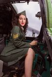Happy pin-up model vintage helicopter stock photos